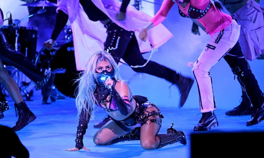 Lady Gaga's Mechanized Mask And Ariana Grande Sparkle In 'Rain On Me' Debut